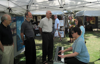 Pastor Ed, Pastor Dave, Laurel and Shelby around piano