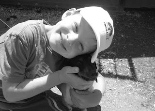 Grateful Boy With Dog
