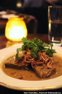 Massaman Neuh: Boneless Beef Ribs with Massaman Curry, Potato, Red Onion, Peanut, and Green Peppercorn at Uncle Boons