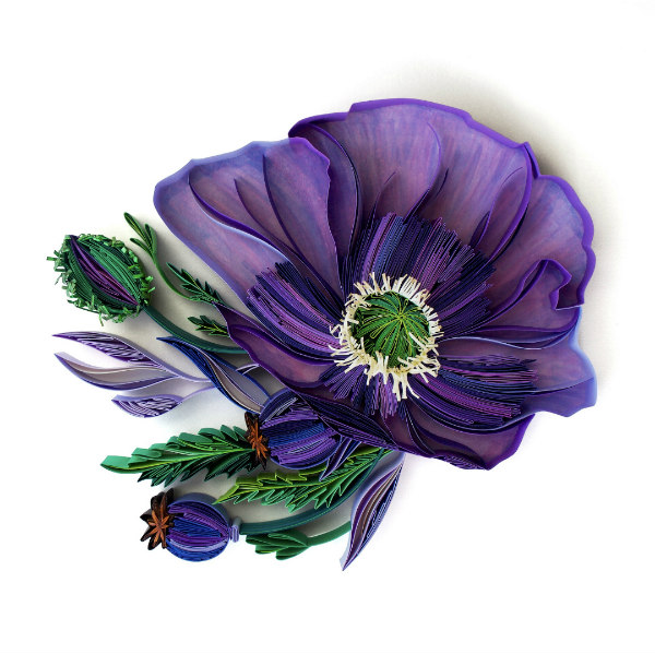 on-edge, quilled purple and green paper flower with fringed center