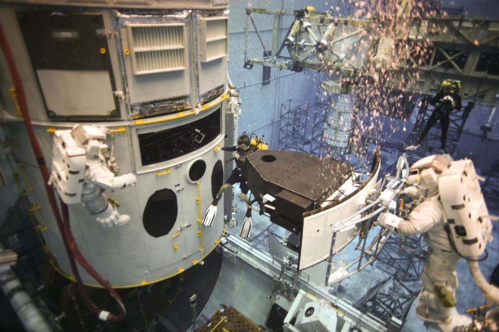Astronauts practising EVA underwater