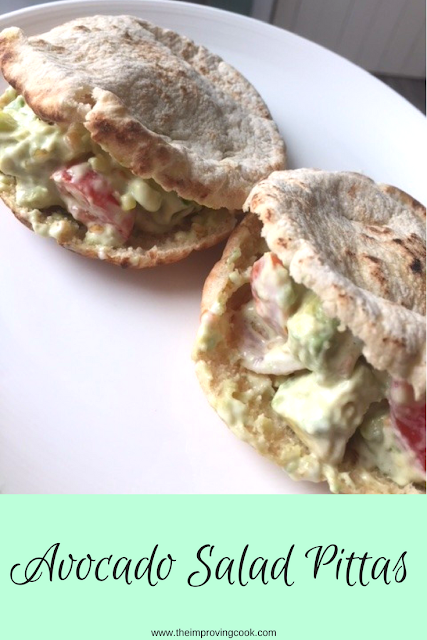 2 toasted pittas filled with avocado salad viewed from above