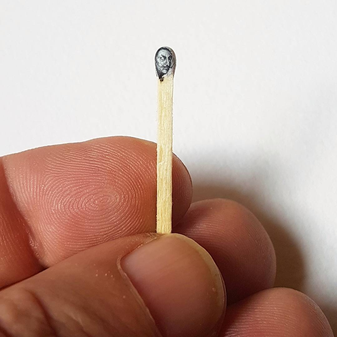 07-Tiniest-Salvador-Dali-Hasan-Kale-Micro-Tiny-Paintings-with-Unusual-Canvases-www-designstack-co
