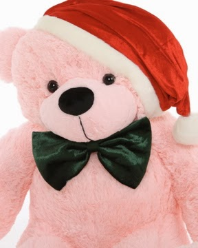 38in Lady Cuddles Christmas Teddy Bear brings pink to the holidays wearing her red Santa hat and green bow tie