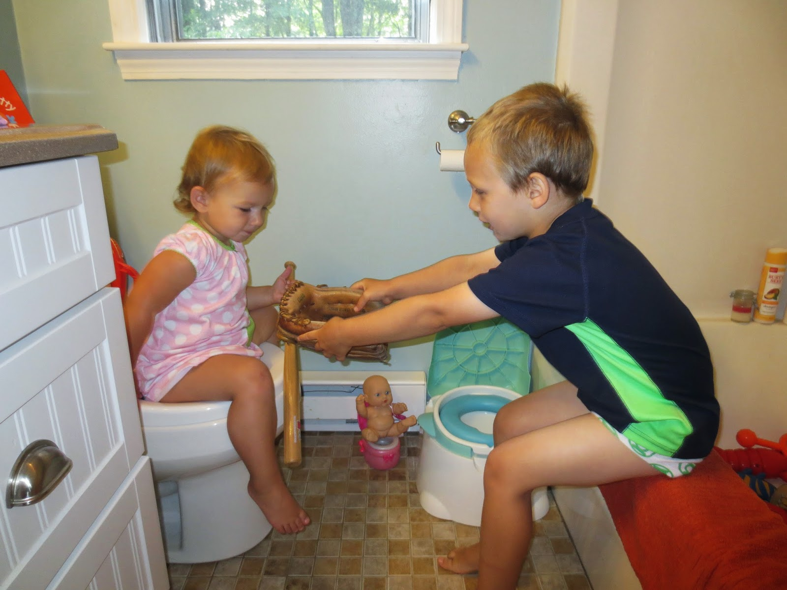 Sister watches brother pee