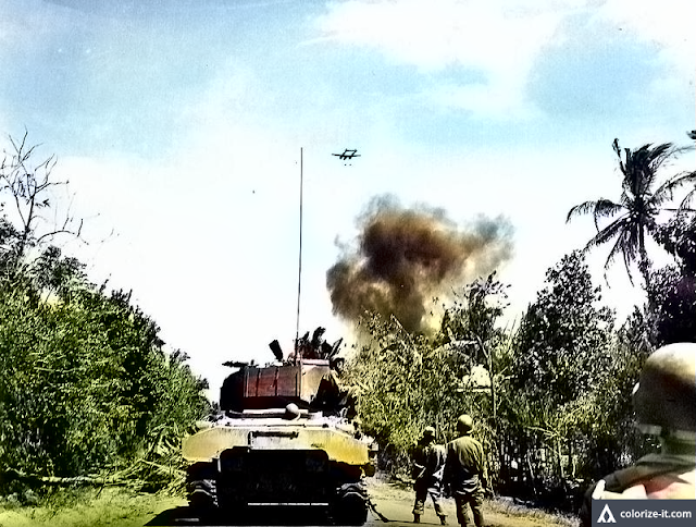 Actual P-38 Lightning attack on Japanese positions in Batangas in WWII.  Image source:  United States National Archives.  Colorized courtesy of Algorithmia.