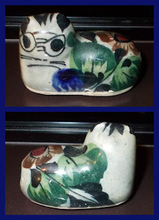 A ceramic cat! Or at least I hope it's a cat, it might be a particularly ugly snark, or a lesser-common, whiskered rock-owl from Planet Zolgon Snnikkitti IV?