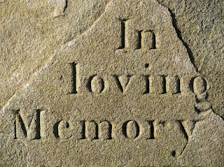 tombstone marking in loving memory