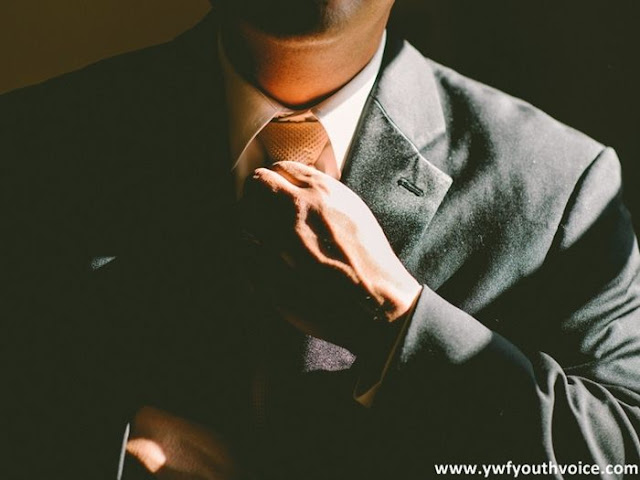 The best time to look for a job is when you don't need one, well suited gentleman with tie getting ready for work