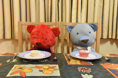 2 teddy bears having afternoon tea