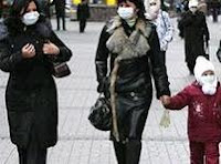 advised people to wear protective masks in public places in an attempt to stop the virus.