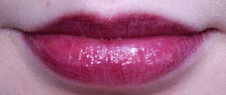 Avon Shine Burst Gloss Stick in Plum Shock lip swatch