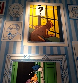 Pic of Tintin paintings on gallery wall at Somerset House, London