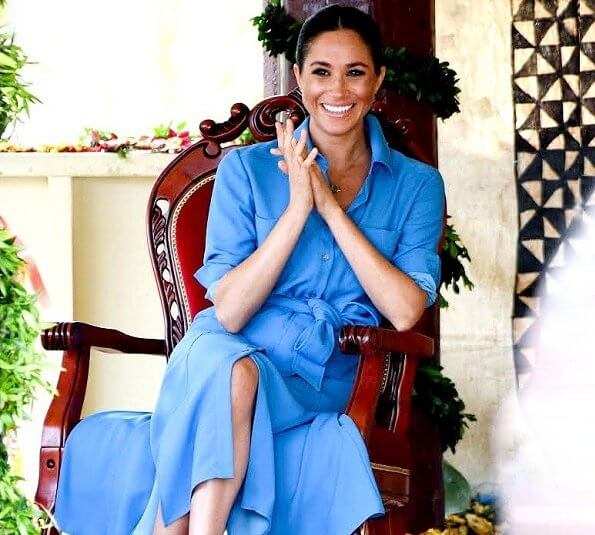 Prince Harry posted a new picture of his wife. Meghan Markle wore Veronica Beard sky blue cara dress
