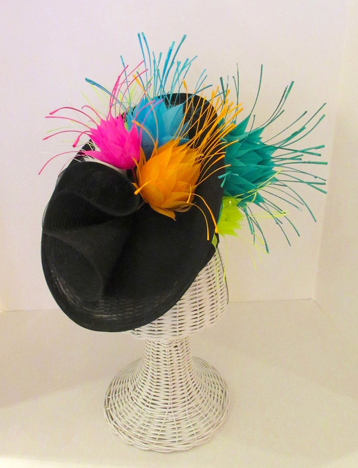 Another of Suzanne s feathered hats features nothing but squares. The hat  is square 9ca7db4816d