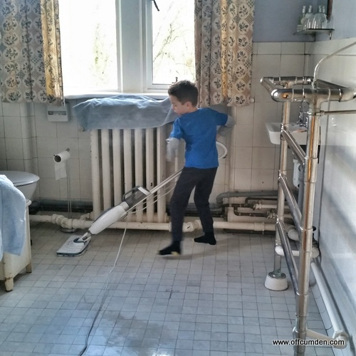 child cleaning bathroom