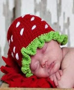 http://translate.google.es/translate?hl=es&sl=en&tl=es&u=http%3A%2F%2Fwww.jennyandteddy.com%2F2014%2F11%2Fstrawberry-crochet-hat-free-pattern%2F