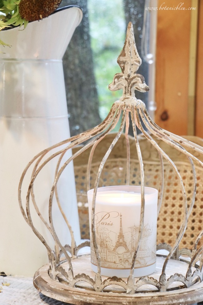 rustic wire cloche adds french country fall to a breakfast sunspace