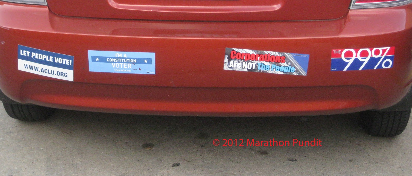 The two bumper stickers on the left are from the aclu the third one reads corporations are not the people