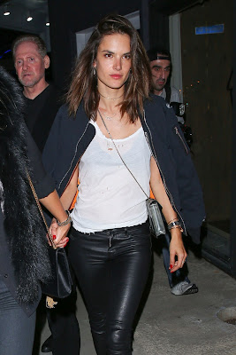Alessandra Ambrosio struts her stuff in skin-tight leather trousers and bomber jacket after partying with footballer pal Neymar
