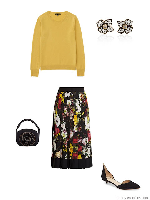 gold cashmere crewneck sweater with floral print skirt
