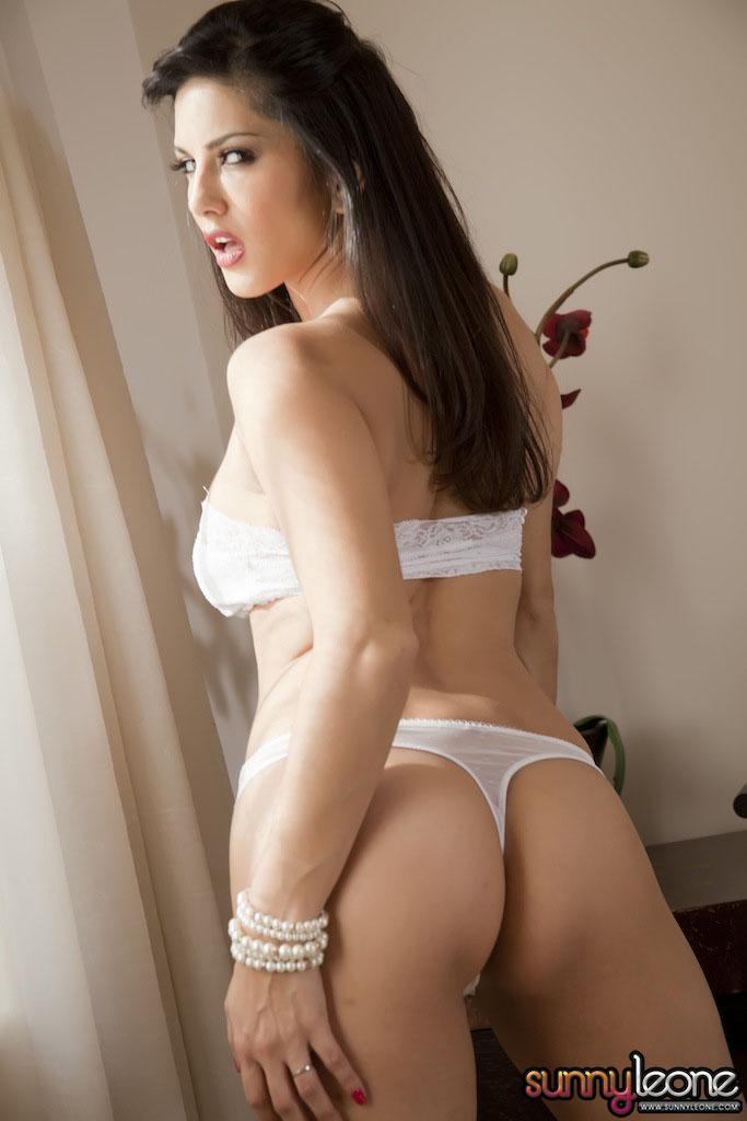 Sunny Leone Exclusive Sexy Photoshoot In White Bikini -9650