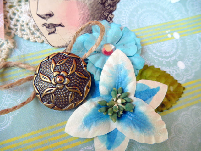 Vintage Button and Flowers on a Scrapbook Layout