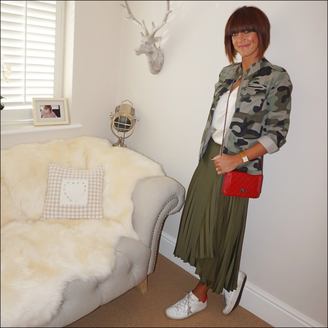 my midlife fashion, hush camouflage military jacket, chanel wallet on chain, marks and spencer silk v neck top, golden goose superstar low top leather trainers, marks and spencer satin pleated midi skirt
