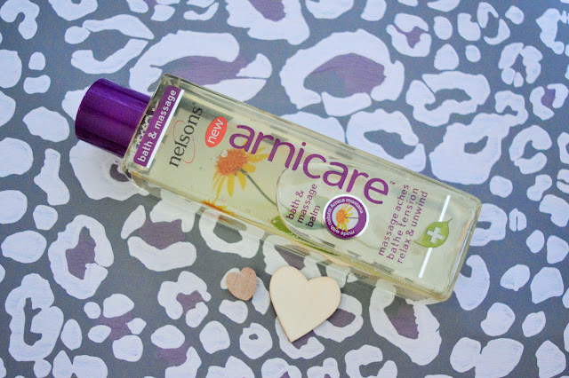 A bottle of Arnicare bath oil.
