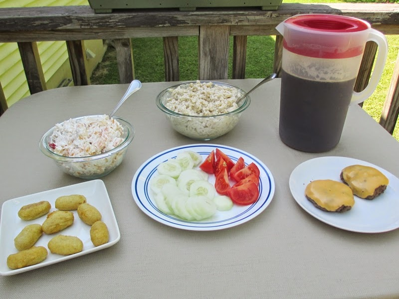 Memorial Day Food Spread including burgers, macaroni salad, and iced tea.