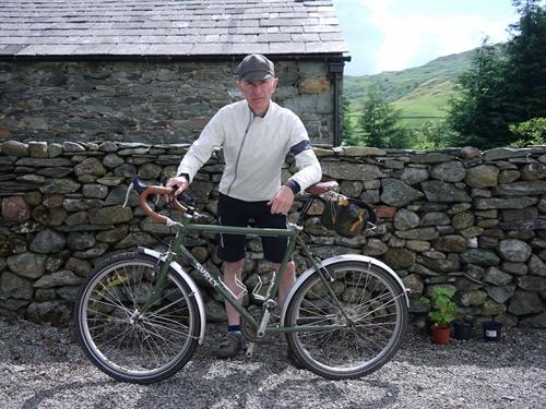 Grey Fox rides off wearing his new tweed cycling cap 71449bdd663