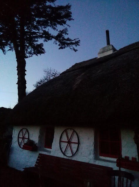 early morning blue light and a thatched cottage