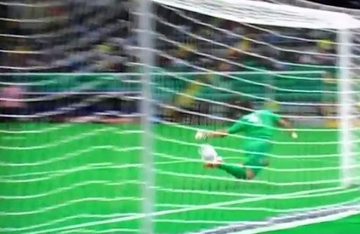 Cagliari goalkeeper Michael Agazzi makes a miraculous save to prevent Fabrizio Miccoli from scoring