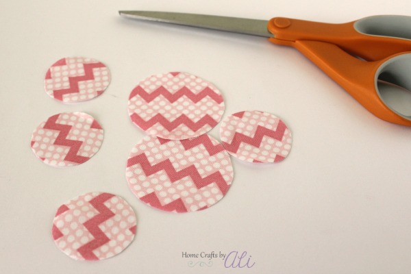 use fabric scissors to cut shapes to decorate tin tub