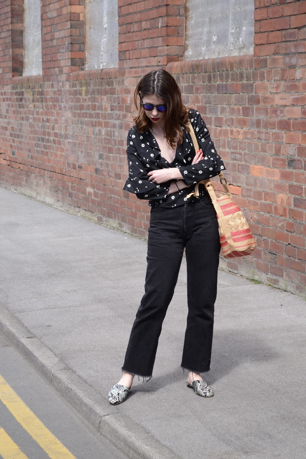 Black levis 501 mom jeans with black floral frill top from Topshop. Summer styling