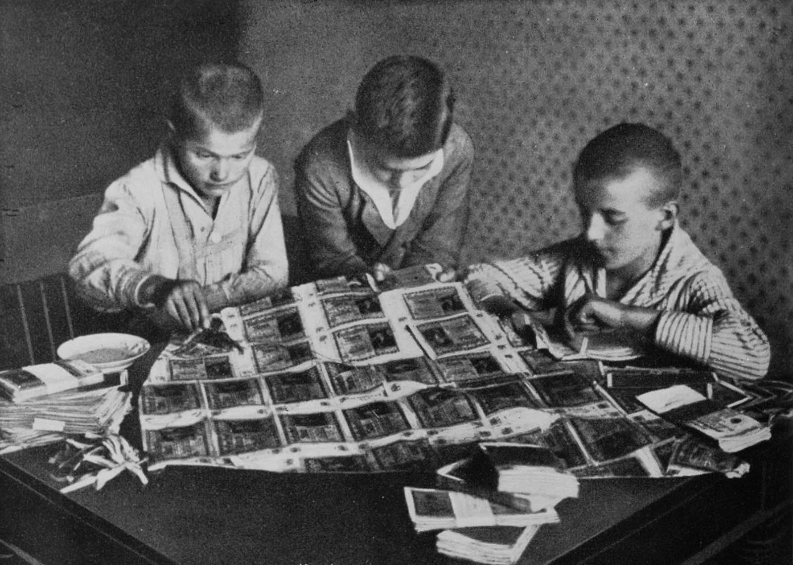 Boys use worthless banknotes for arts and crafts. 1923.