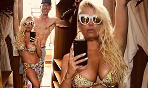 Jessica Simpson postures in a two-piece !! jessica simpson,simpson,jessica,jessica simpson (celebrity...