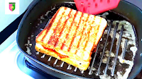 image of grilling sandwich on another side on pan