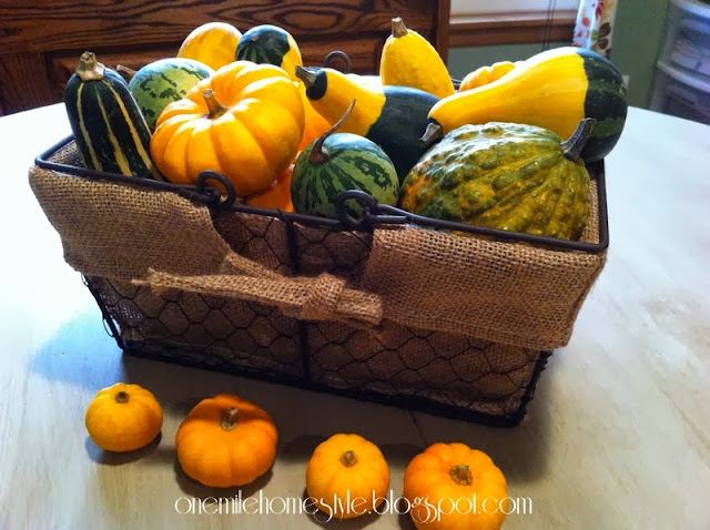 Wire basket full of fall gourds