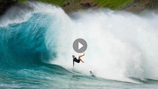 PRO SURFERS TAKE ON HUGE SHOREBREAK