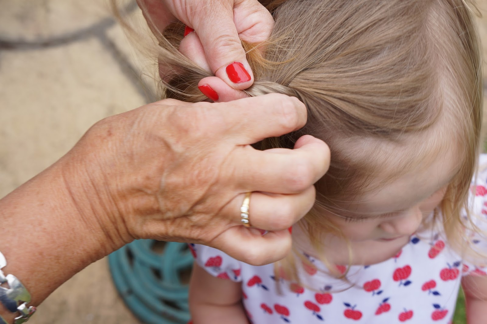 nanny plaiting toddler girl hair