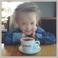 young girl with Costa babyccino