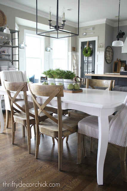 White kitchen table with wood chairs