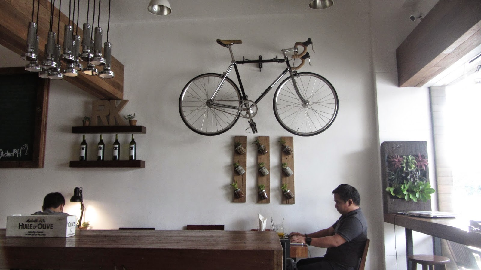 runners kitchen islands carts runner s at tomas morato avenue walkandeat i like the whimsical decor with a bike lording over dining area