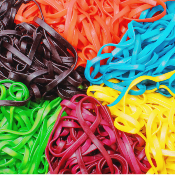 Explore all of the senses with rainbow dyed sensory noodles!  Making this colorful rainbow spaghetti is easy, and there are so many fun ways for kids to play and explore! #rainbowdyednoodles #rainbownoodles #rainbowspaghetti #sensoryactivitiestoddlers #sensoryactivities #sensorybins #coloredpasta #colorednoodlessensory #howtodyepasta #howtodyenoodles #growingajeweledrose