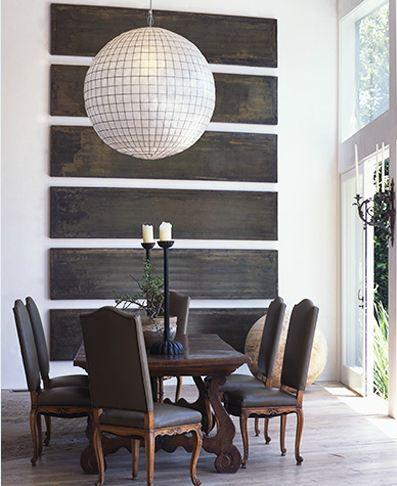 lisa romerein's dining room with oversized pendant light, reclaimed wood slats wall art, louis xv chairs and a wood table
