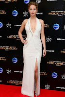 Inspiring! Jennifer Lawrence is all smiles as she arrived the Hunger Games after party in a magnificent long white gown.