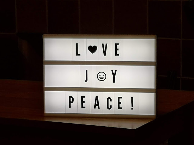 Light box saying love, joy and peace