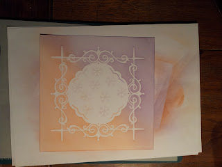 Purple and orange stencilled background with frame and snowflakes