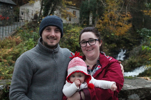 family in front of waterfall at rydal gardens lake district ambleside